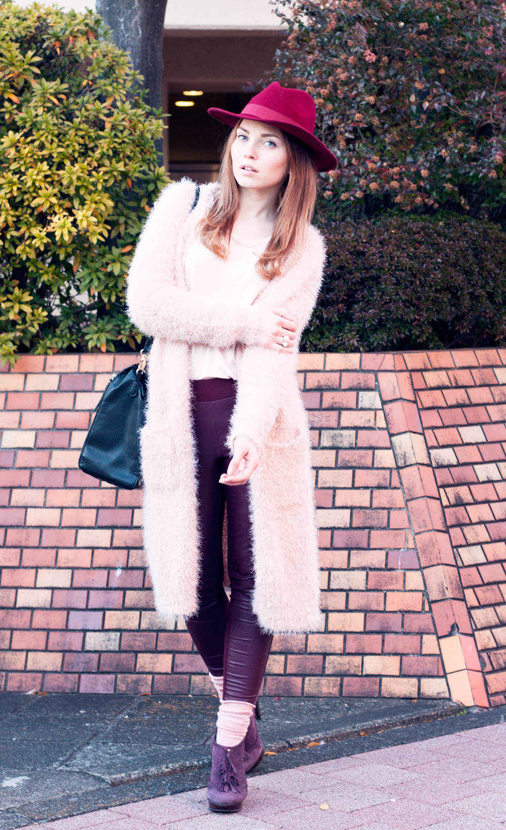 wine colored hat, hat, wine red leather pants, fuzzy cardigan, tokyo, japan, leopard bag, purple heels, fringe, pink double pearl earring