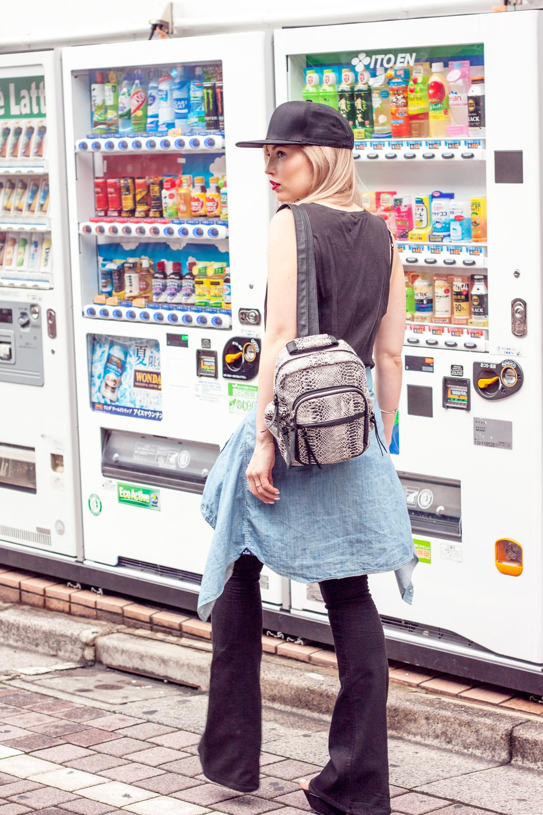 Ikebukuro, Japan, tokyo, denim shirt, flared black jeans, baseball cap, red lips, face stockholm lipstick, reptile backpack