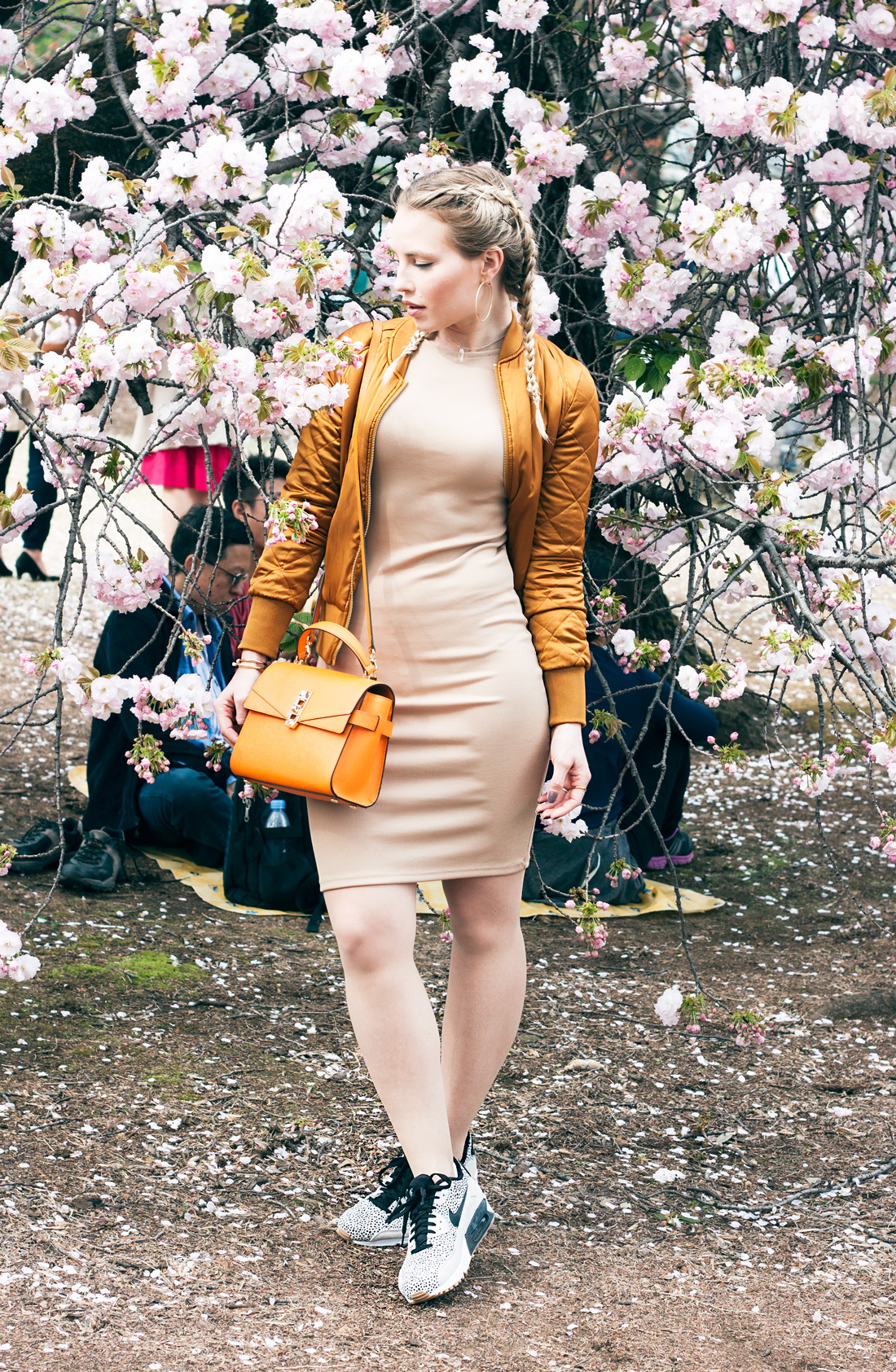 cherry blossoms, spring tokyo, tokyo, japan, spring 2016, late blooming cherry blossoms, boxer braids, dutch braids, tokyo blog, pink cherry blossoms, braid addict, gold bomber jacket, nude dress, orange handbag, henri bendel handbag, hoop earrings
