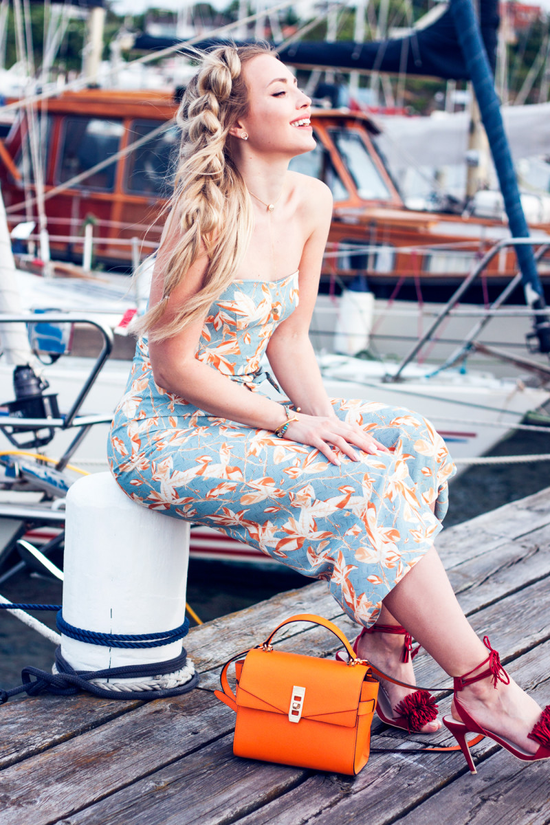 Breakthrough Fashion Blogger of the Year bloglovin competition, h&m jumpsuit, flower jumpsuit, pull through braid, rapumzel clip in extensions, henri bendel bag, orange handbag, red tassel shoes, red fringe heels, red fringe shoes, colourful jumpsuit, swedish archipelago, yacht week, boats in sweden, hamn i saltholmen, man repeller competition, bloglovin competition